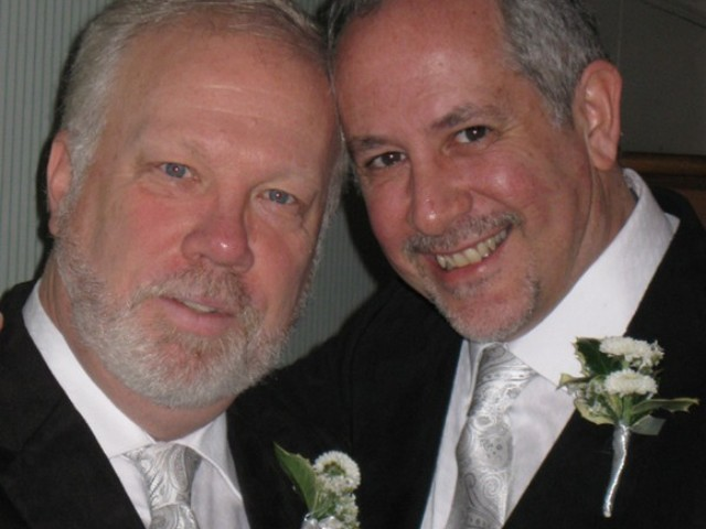 Darren Nimtich (l) and Tom Cicero (r) on their wedding day. The couple lost their pet cat Kelly in the fire.