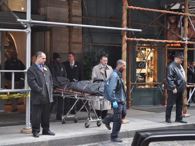 Mark Madoff's body is brought out of the Mercer Street apartment Saturday afternoon.