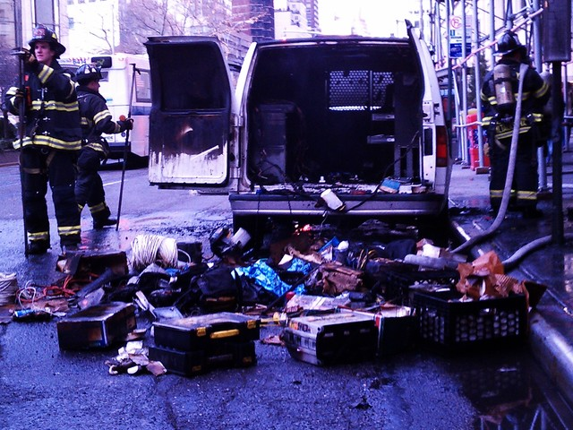 The van's contents were strewn onto Broadway as the FDNY worked to put out the fire.