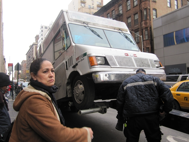 Patricia Monroy, of Paty's Taco Truck, watches as police tow her business, Jan. 20.