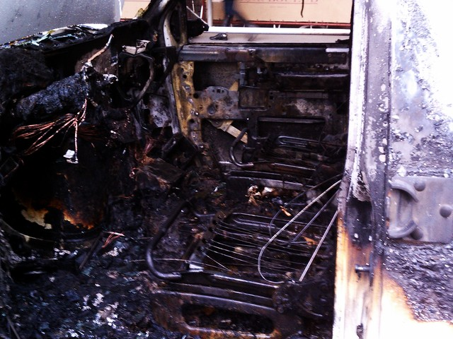 The front seats of the van were completely destroyed and the steering wheel was melted by the flames.
