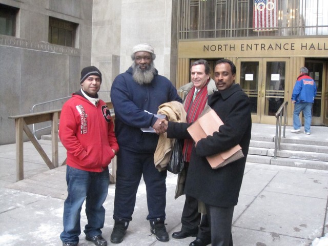 Chess players Chris Peralta (from left) and Yacahudah Harrison celebrated with their attorneys Norman Seigel and Earl Ward after a judge dismissed the case against them.