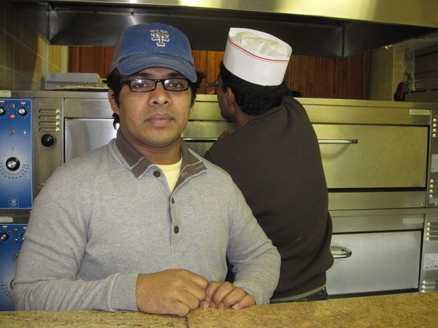 99 Cent Pizza Manager Imran Ahmed.