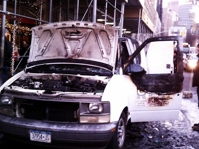 The driver's side door was blackened after the van caught fire.