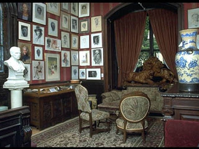 The National Arts Club's Music Room with portraits of Isaac Stern, Tennessee Williams, Toni Morrison and others
