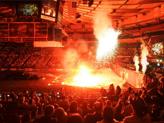 Bull riding fans watch a pyrotechnic display before the evening session of the Professional Bull Riders Versus Invitational at Madison Square Garden on Jan. 6, 2007.
