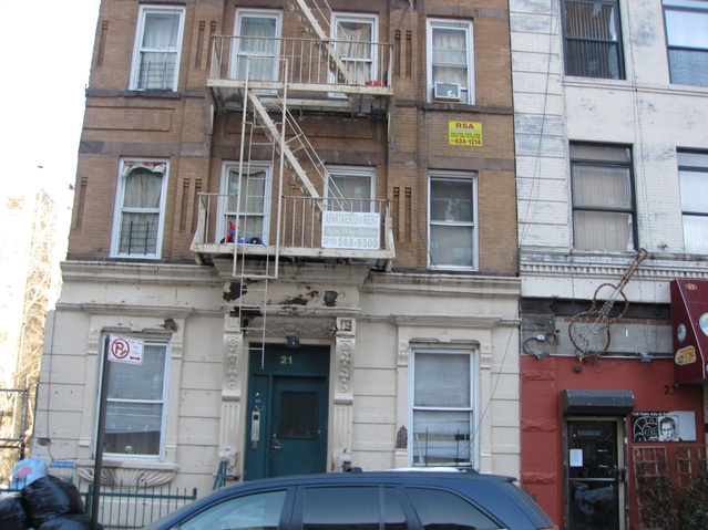 The tenement at  21 East 115th St. where residents say they have had no heat or hot water for two weeks.