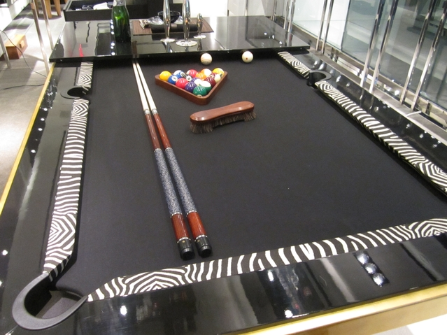 Pool table/dining table with gold leaf ($49,000) at the OC Concept Store. Custom variations start at $10,000.