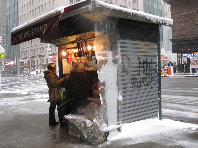 The awning at this Sixth Avenue newsstand protected customers from the elements.