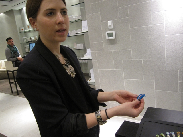 Ashley Orfus shows off cyrstal earbuds ($98 - $150) at the OC Concept Store.