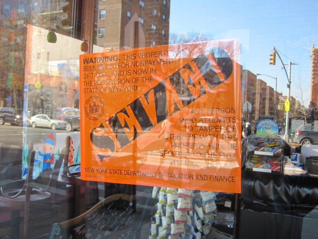 A sign taped to The Bean's front door stated that the property was seized by the state for failure to pay taxes.