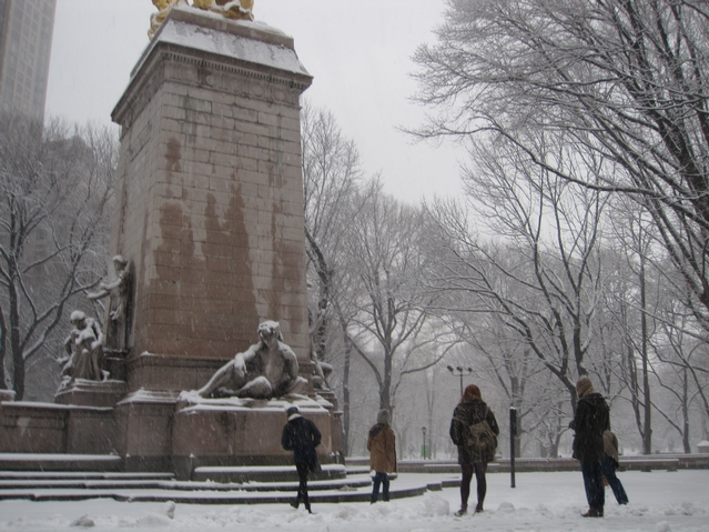 The Bugler family from London, England held a snowball fight in Columbus Circle during Monday's snowstorm.