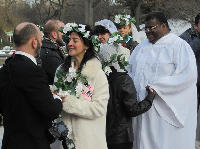 About a dozen couples braved the cold Sunday to un-exchange wedding vows at the Bethesda Fountain in Central Park until all couples, including LGBT partners, can marry under the law.