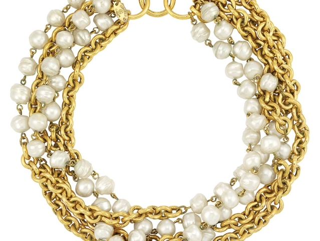 Chanel Necklace with Gold Tone Metal Links and Faux Baroque Pearls. Estimate: $1,000 - 1,200