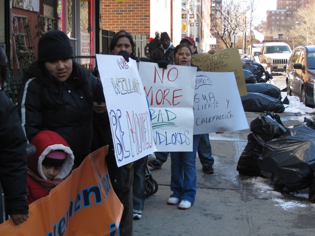 Residents protest living conditions outside of their building at 21 E. 115th St.