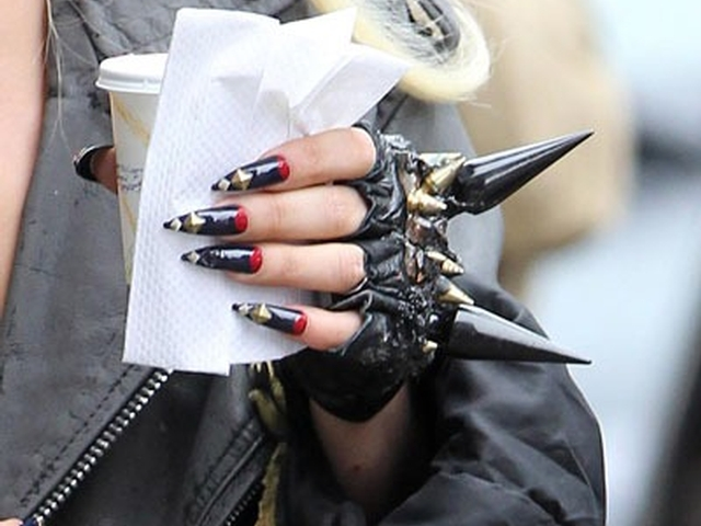 Lady Gaga's killer manicure included red and black pointy nails with metal studs and a pair of black fingerless spiked gloves.