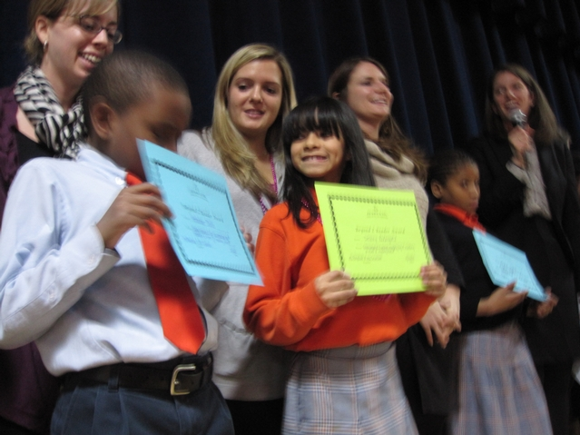Harlem Success kids with their reading certificates.