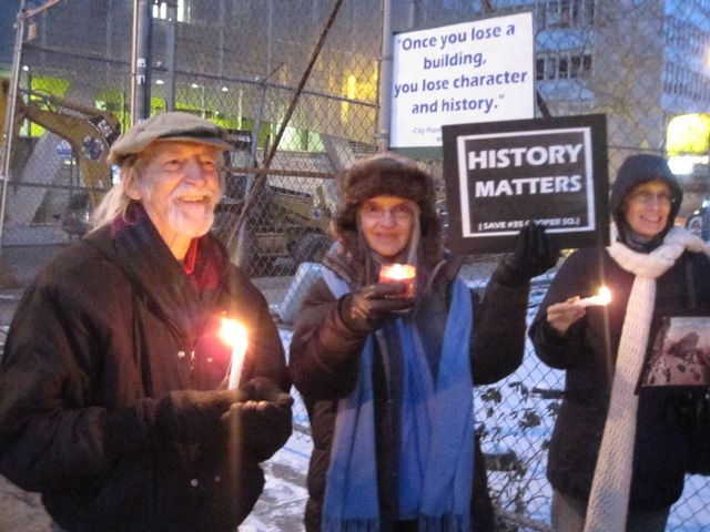 Demonstrators gathered for a candlelight vigil in front of 35 Cooper Square.