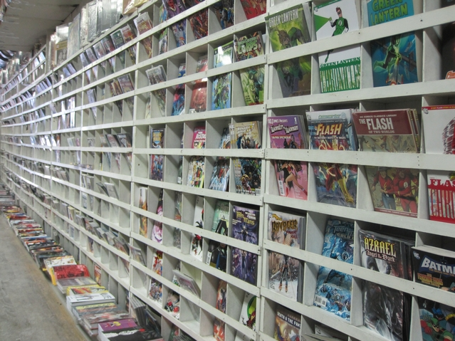 Hundreds of comic books line the store's wall.