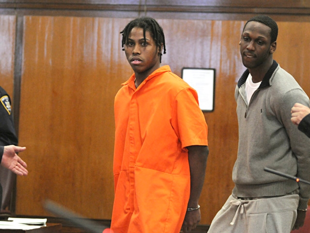 Alleged gang members Tyrone Gibbs (L) and Laquan Lane (R) at their arraignments Wednesday.