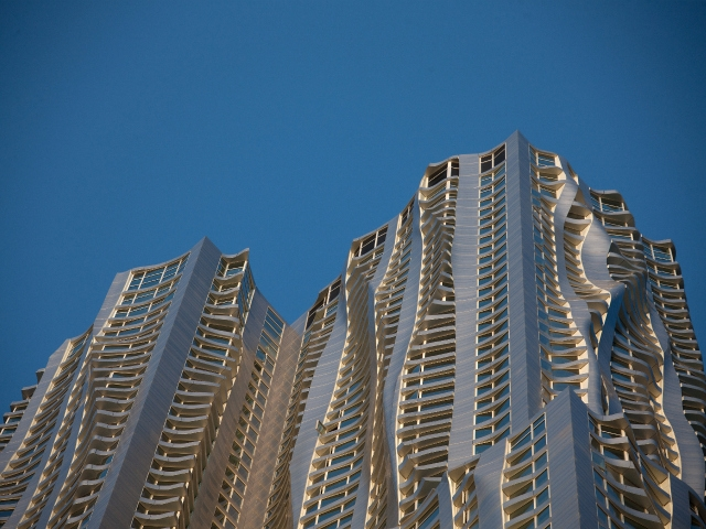 The tower's rippling stainless steel facade looks shines in the sun.