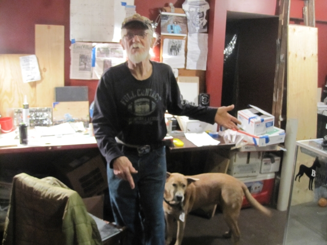 Power with his dog Jessie Jane in his studio space on E. 5th Street.