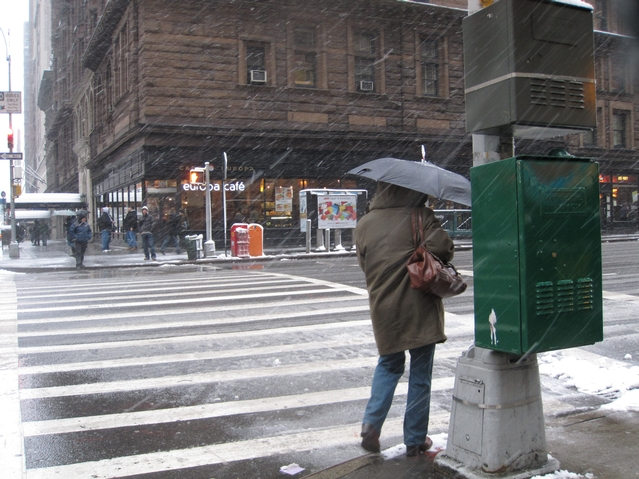Commuters used umbrellas to deflect the snow as Monday morning.