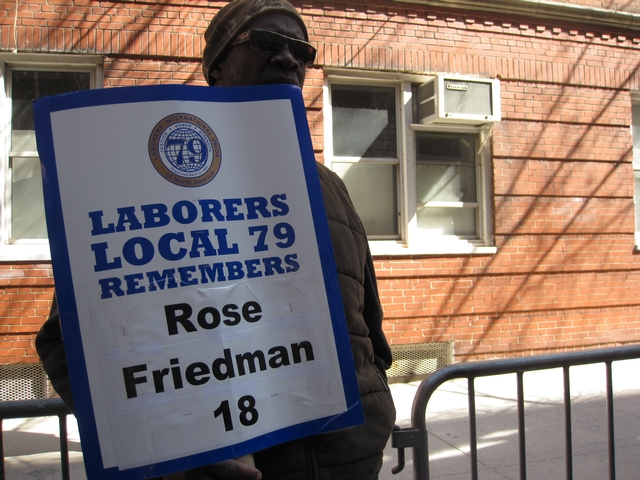 Local Labor union members carried placards remembering victims.