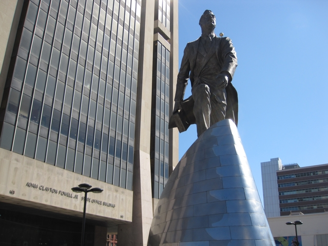 A statue of Adam Clayton Powell Jr. in the plaza of the state office building named after him.