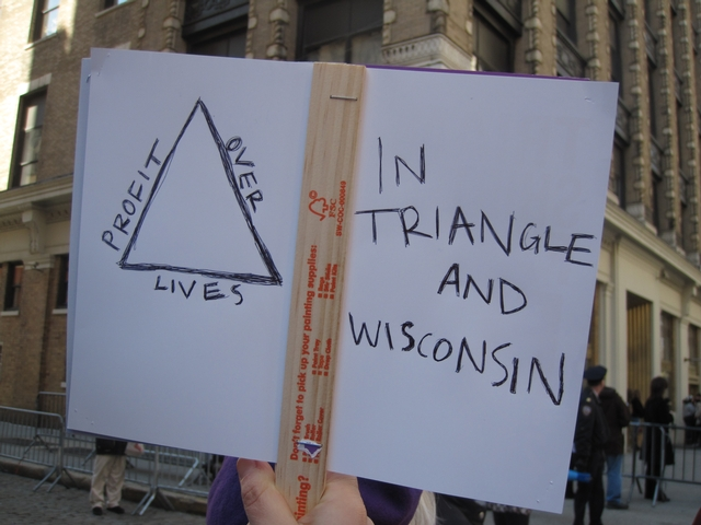 Wisconsin protest sign held at the 100th anniversary of Triangle fire.