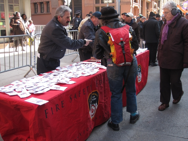 The FDNY passes out fire safety information.