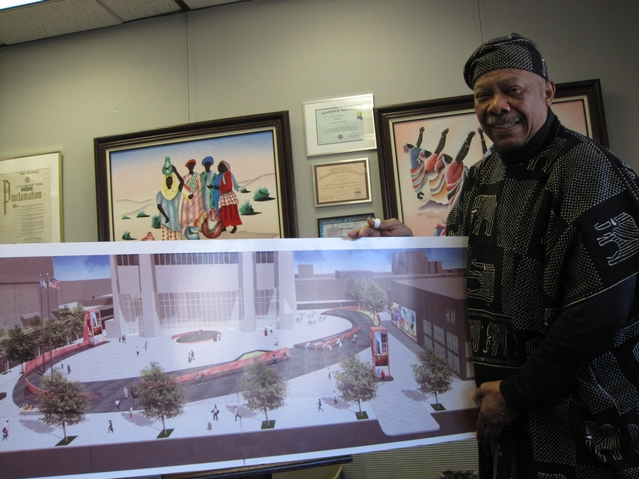 Willie Walker, general manager of the Harlem State Office Building, with a rendering of the plaza.