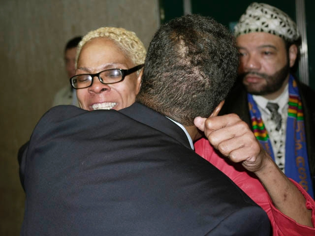 Karen Owes, mother of jailed Harlem teen Afrika Owes, hugs supporters after a judge allowed her church to post bail.