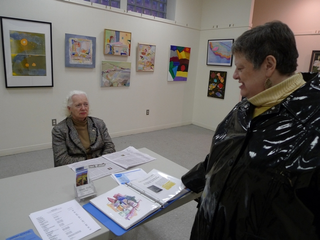 Volunteer and artist Beatrice Rubel, left, and co-curator and artist Anne Rudder at the Broadway Mall Community Center.