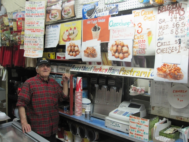 Ray Alvarez stood next to the ever-evolving menu at his 36-year-old Avenue A shop on a recent weeknight.