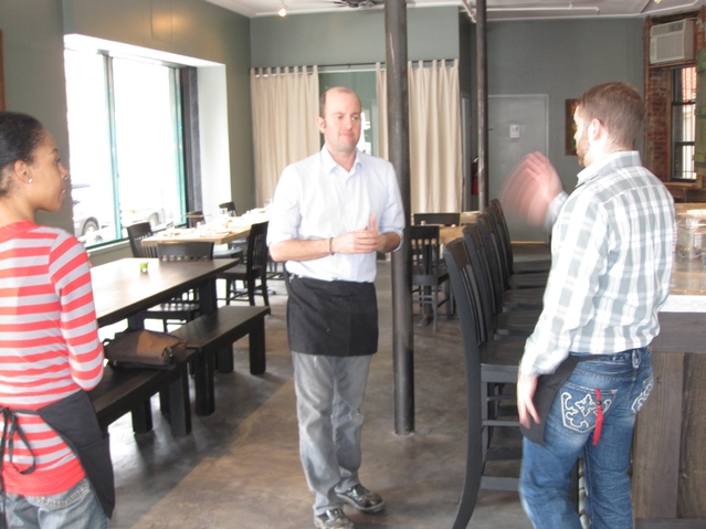 Bad Horse Pizza owner John Kandel helped prepare staff for Friday's grand opening.