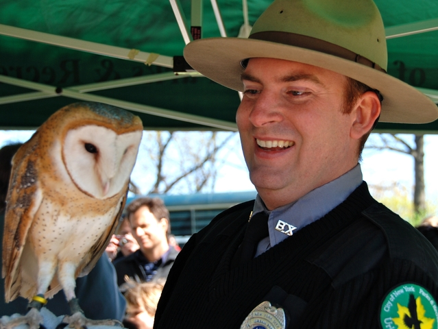 A Parks Ranger displays an owl at the 2010 Urban Wildlife event.