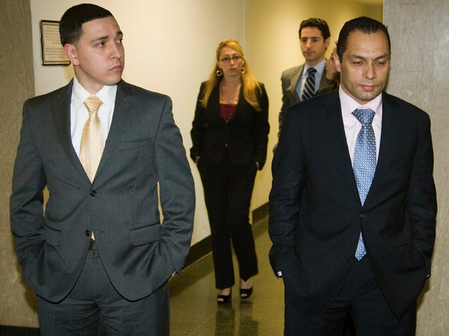 Police officers Franklin Mata, 29, and Kenneth Moreno, 43, on the first day of jury deliberations.