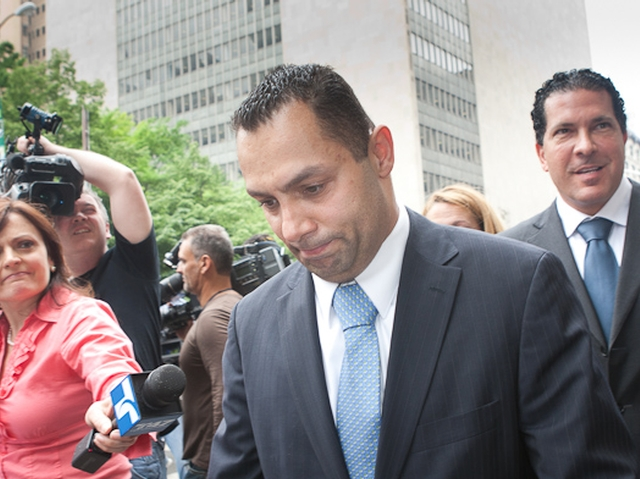 Kenneth Moreno (L) leaves Manhattan Supreme Court followed by his lawyer, Joseph Tacopina (R), May 26, 2011.