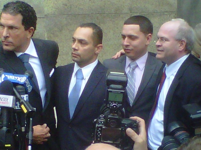 From left: Attorney Joseph Tacopina, Officer Kenneth Moreno, Officer Franklin Mata and Attorney Edward Mandery exit Manhattan Supreme Court Thursday after Mata and Moreno were found not guilty on rape charges.