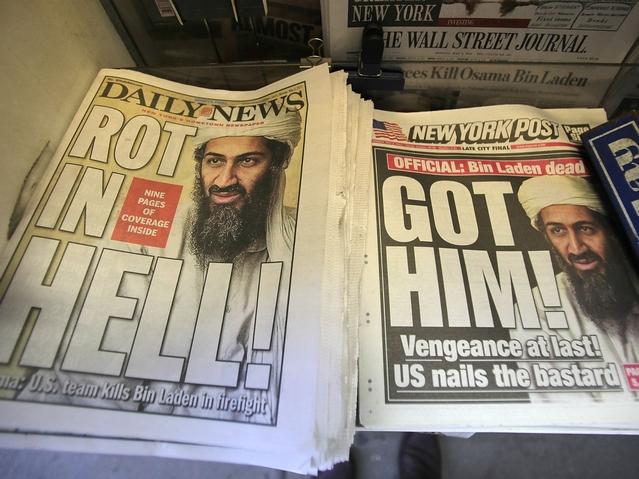 Bin Laden center walks with. Osama in Laden is Dead