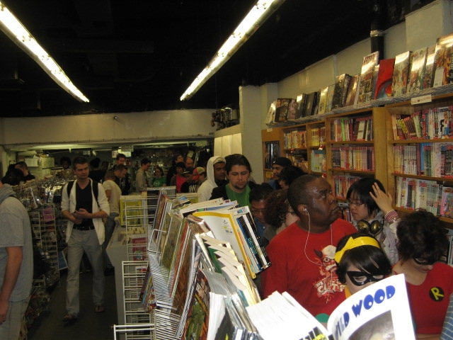 The fans bide their time patiently Saturday for free comics at Jim Hanley's Universe on Free Comic Book Day.