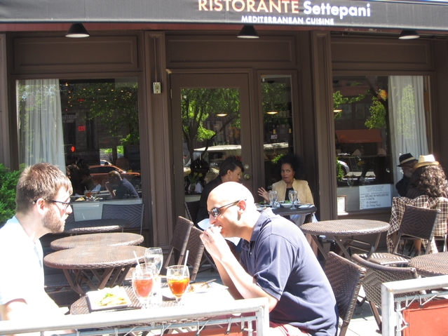 Diners at Ristorante Settepani's sidewalk cafe.