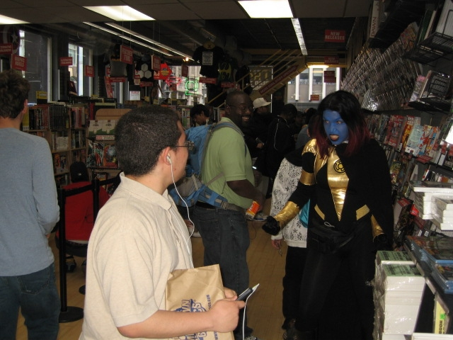 A customer at Midtown Comics is surprised by a colorful greeter on Free Comic Book Day on Saturday, May 7, 2011.