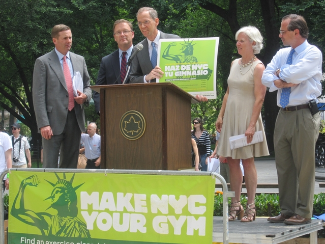 Health Commissioner Thomas Farley at Madison Square Park on Monday showing off the new logo — Lady Liberty flexing her muscle — for Make NYC Your Gym week.