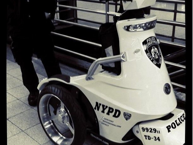 A three-wheeled NYPD Segway scooter.