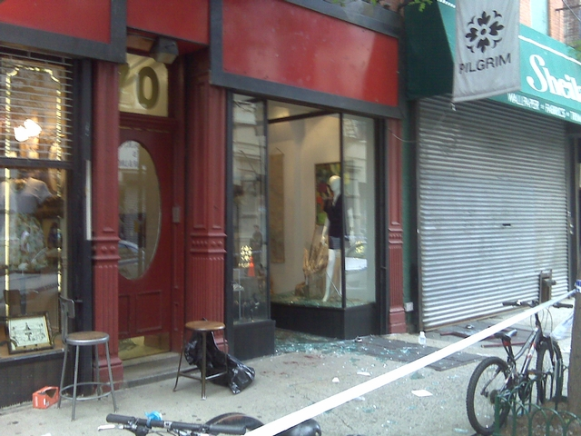 Shattered glass covers the sidewalk in front of Pilgrim vintage clothing store at 70 Orchard St.