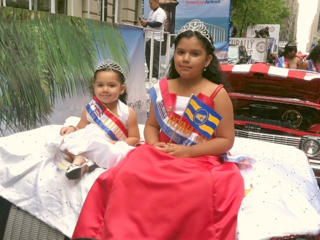 Cute. Shasha Cevallos, 3, (l.) and her sister, Mercedes, 10, are representing the Puerto Rican town of Casa Guanica.