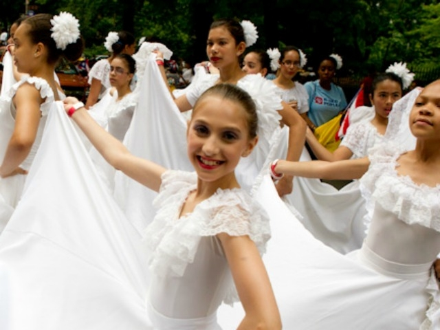 A girl dances in the Puerto Rican Day parade.