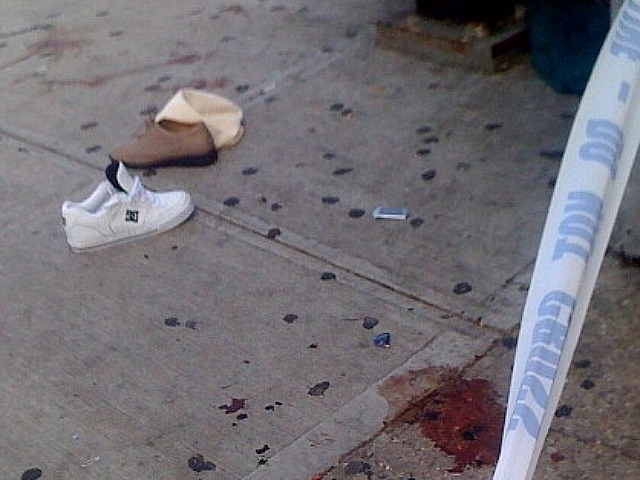 The shoes of a Harlem woman were left behind on the blood-stained sidewalk after she was struck by a car.